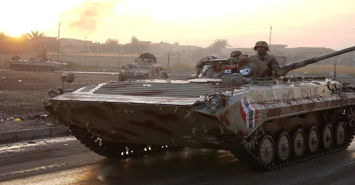 An Iraqi Army tracked vehicle patrols the streets as U.S. and Iraqi soldiers are executing a combined cordon and search in Ghazaliya, Iraq on December 21, 2006. (U.S. Army photo by Sgt. Martin K Newton) (RELEASED)