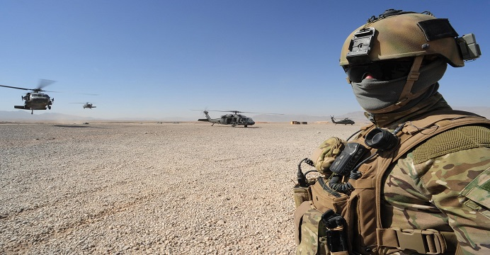Photo by: Corporal (CPL) Chris Moore Caption: A Special Operations Task Group (SOTG) soldier waits for US UH-60 Black Hawk Helicopters to land at Multi-National Base Tarin Kowt airfield. Middle Caption: Soldiers from the Special Operations Task Group (SOTG) and the Afghan Provincial Response Company (PRC) recently conducted partnered operations in the Shah Wali Kot Region of northern Kandahar province, Afghanistan. The missions, a continuation of the strike and disrupt activities conducted previously, saw the partnered forces successfully capture insurgents, numerous weapons and material for the manufacture of Improvised Explosive Devices (IEDs). Partnered operations between SOTG and the PRC place pressure on the insurgency and have an impact on the Talibanís ability to threaten the lives of Afghan civilians, the Afghan Forces and members of the International Stabilisation Assistance Force (ISAF).